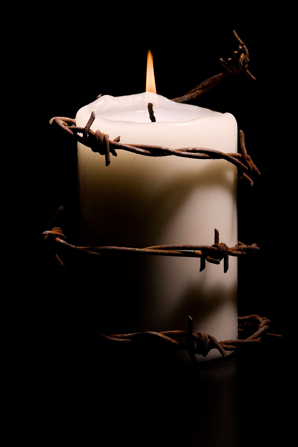 candle wrapped with barbed wire